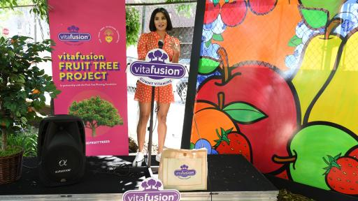 Diane Guerrero on a stage discusses why advocating for good, fruitful nutrition is one of her top priorities.