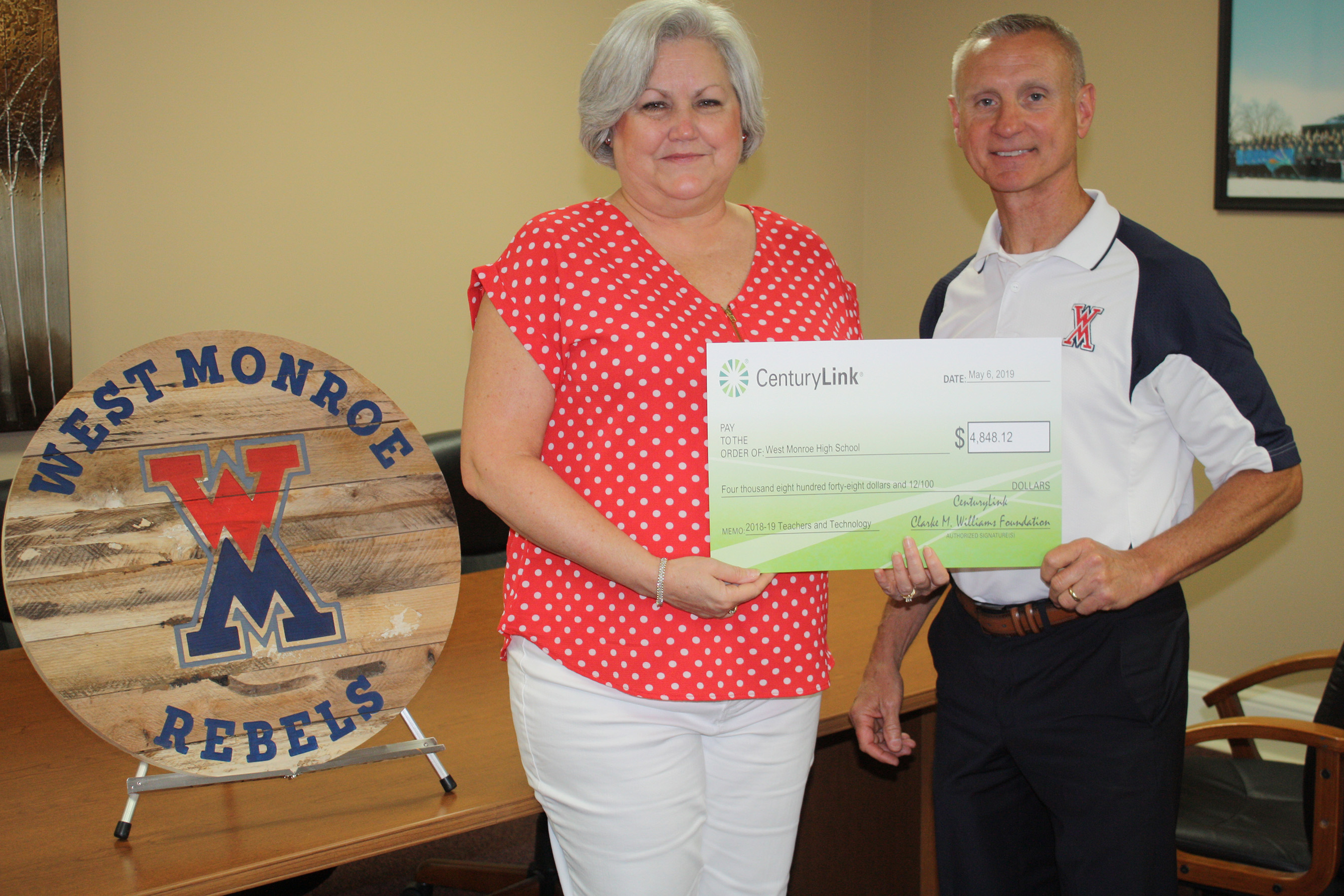 West Monroe High School in West Monroe, Louisiana, used its CenturyLink grant to purchase Chromebooks for social studies learning activities. From left are West Monroe teacher Mitzi Murray and principal Shelby Ainsworth.