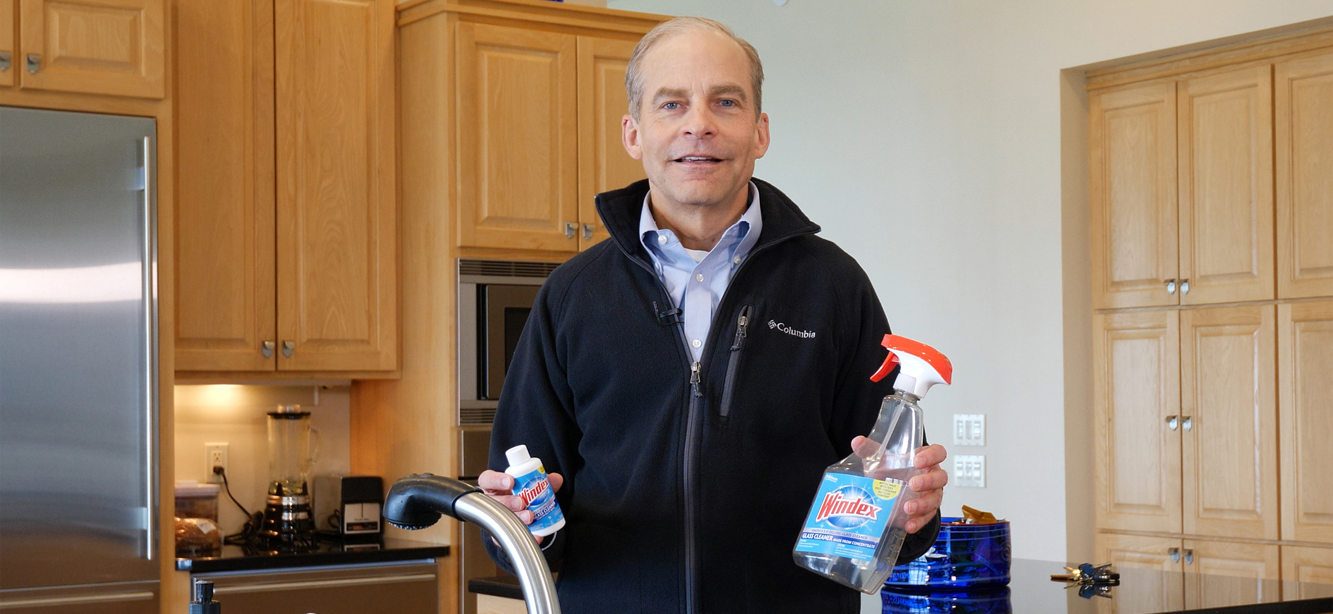 Fisk Johnson holding Windex bottles