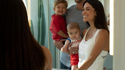 The Phelps family look at their teeth in a mirror and turn off a facet.