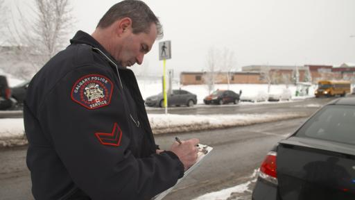 Police Officer writes Second Chances ticket for a Calgary resident