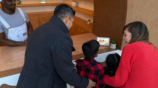 A family watching a video on a device