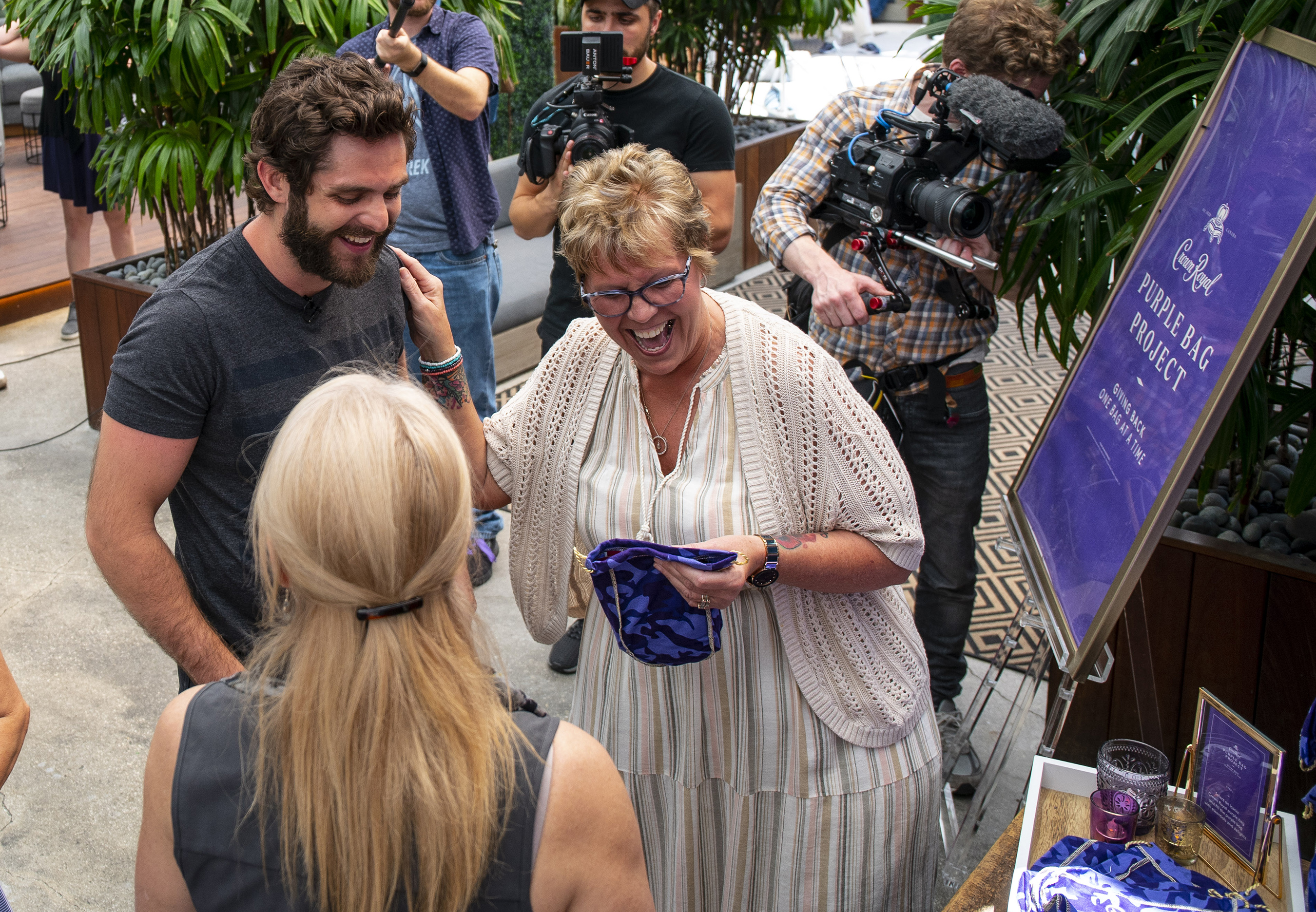 Ahead of the surprise reunion, the Mothers of Military joined Crown Royal Purple Bag Project partner Thomas Rhett and Packages From Home, a 501(c)(3), to assemble care packages for the brave men and women currently serving overseas.