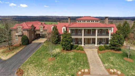 Front view of a large sprawling mansion on Carlise Hill.