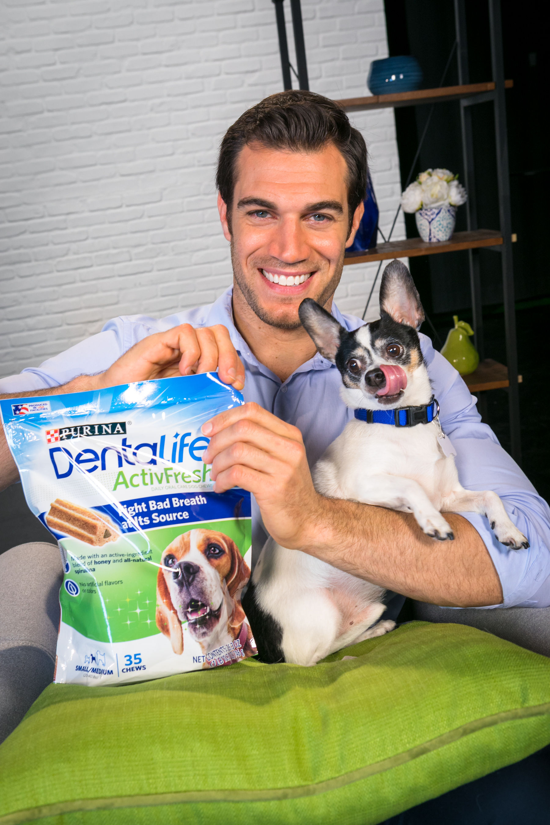 "Well-known veterinarian and host of Animal Planet's ""Evan Goes Wild,"" Dr. Evan Antin and his dog Henry partner with Purina DentaLife to launch ActivFresh daily oral chews, a new breakthrough technology that goes beyond simply masking bad breath. The new chews are made with an active-ingredient blend of honey and natural spirulina and have been scientifically tested to fight bad breath at the source."