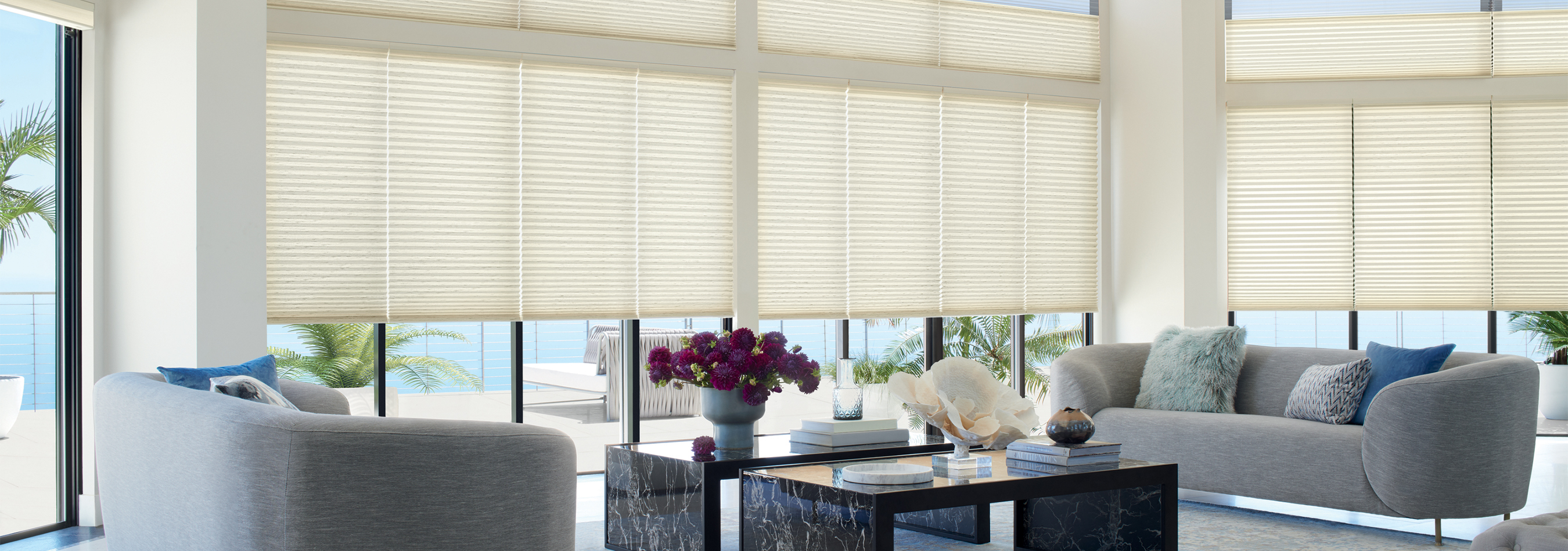 Large room surrounded by windows with beautiful translucent blinds.