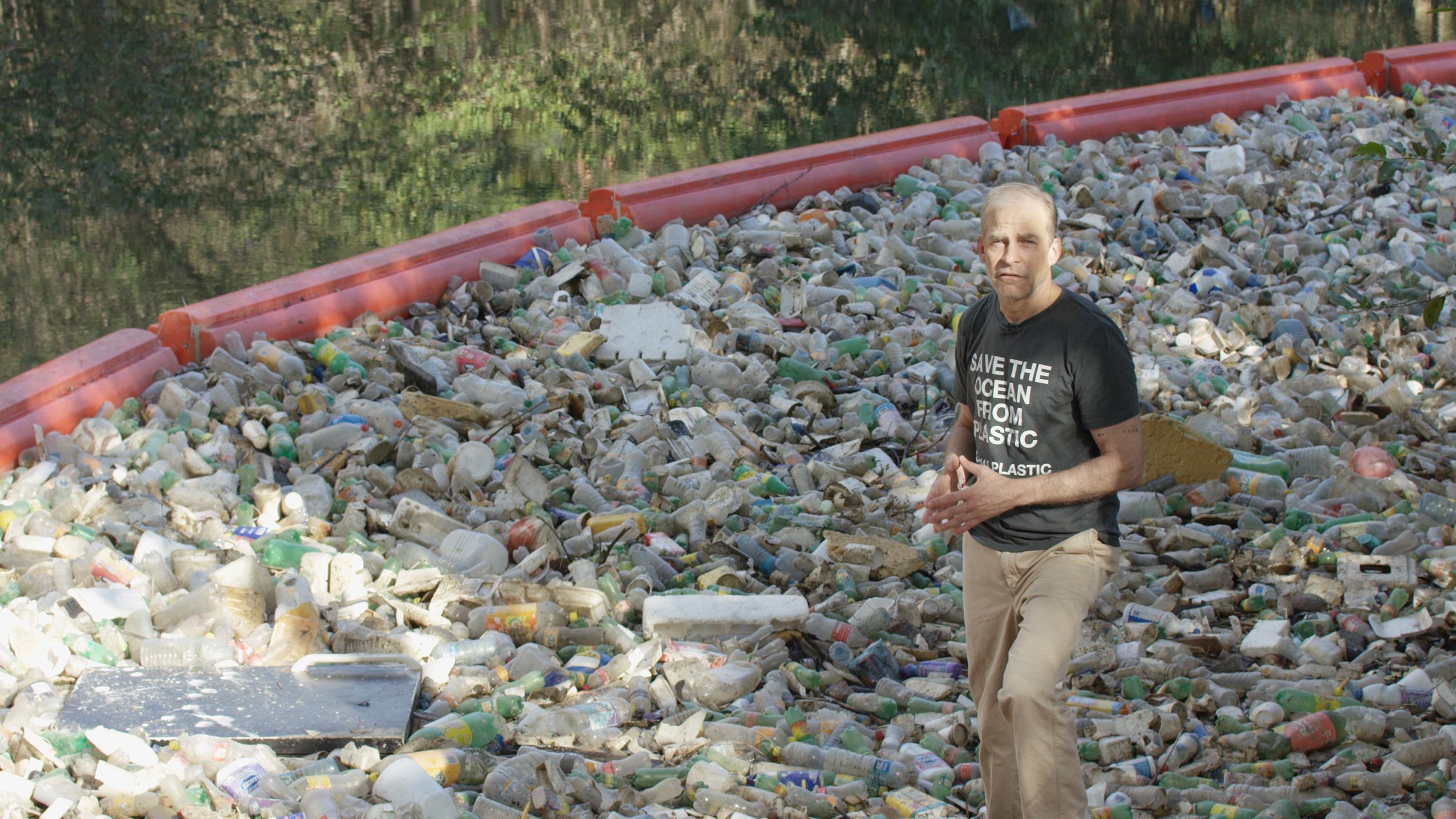 Fisk Johnson at the site of a river barrier built to prevent plastic from reaching Panama Bay, and eventually the ocean.