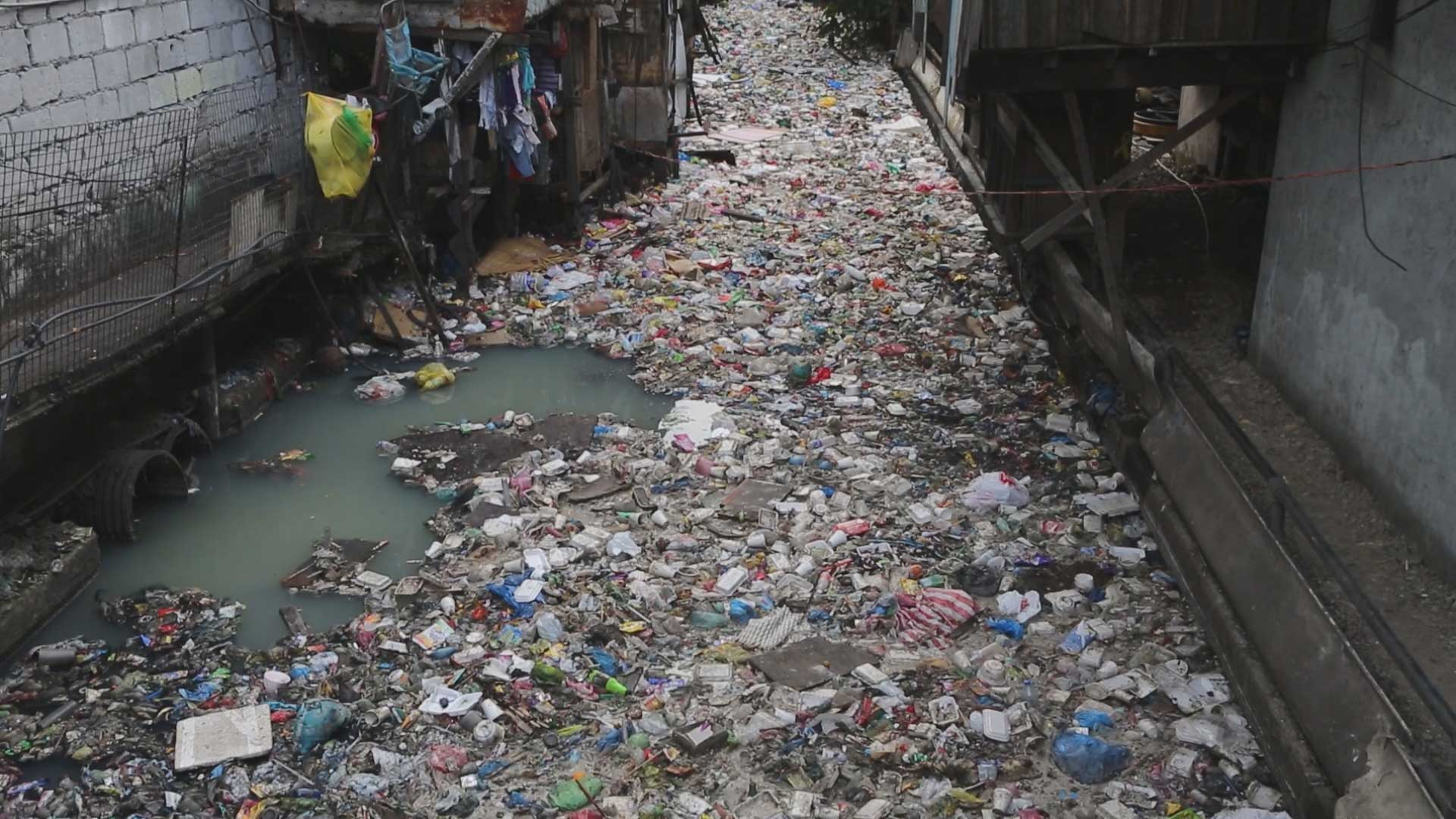 Waste flows in the Estero de Magdalena, one of the main estuaries in Manila, Philippines.