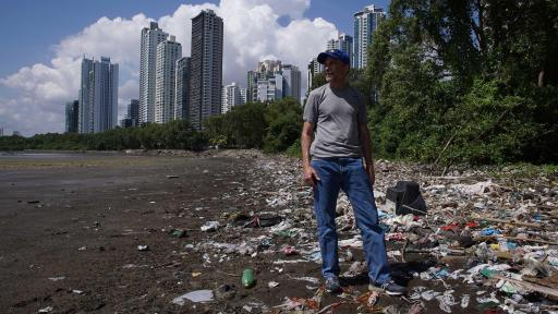 Image of the Turning the Tide sustainability guide in front of a beach full of garbage