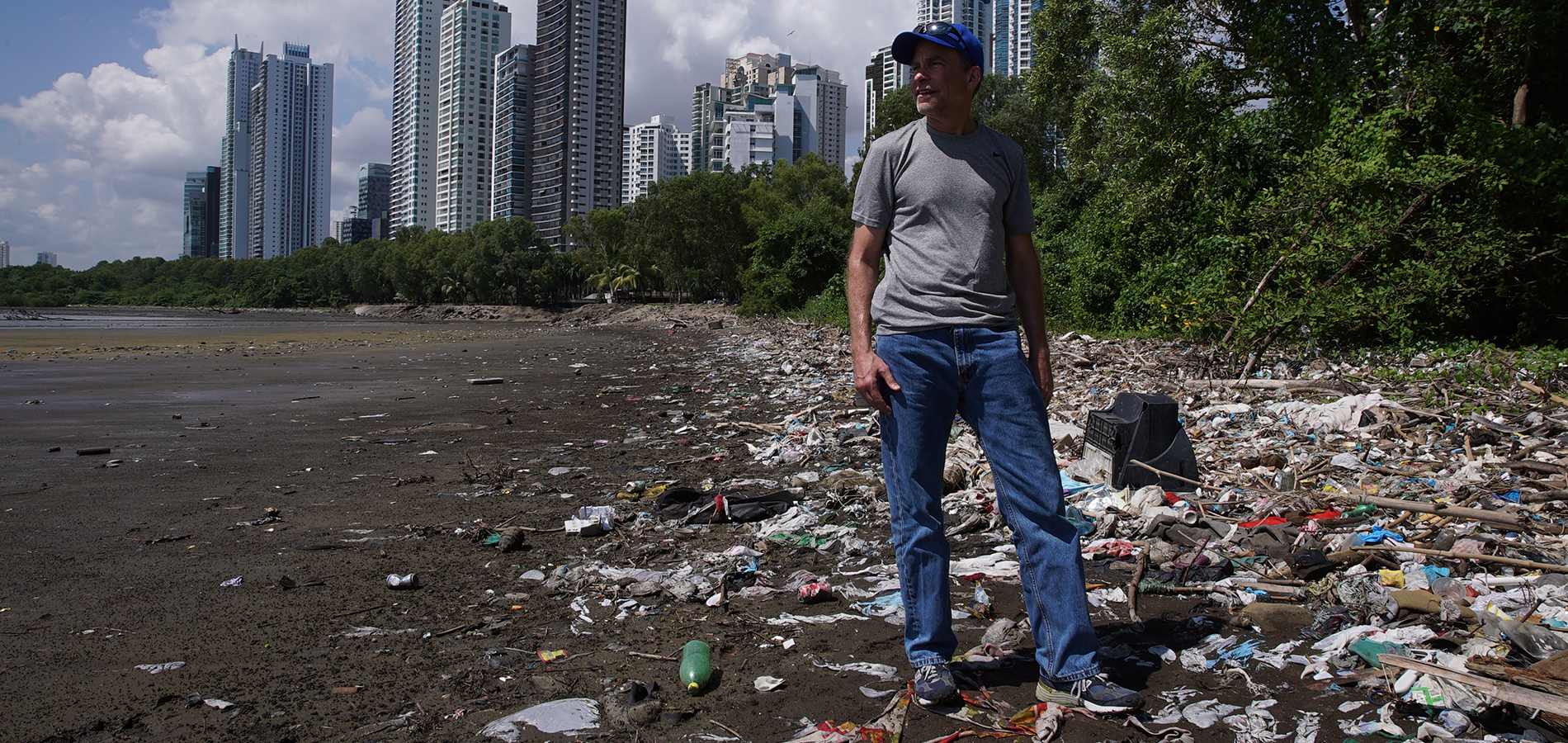 Hero image of the Turning the Tide sustainability guide in front of a beach full of garbage