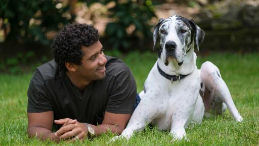 Pro football champion and pet advocate Russell Wilson enjoys a moment with his dog, Naomi, while filming the Safer Together™  public service announcement (PSA) with the Banfield Foundation® on Wednesday, May 15, 2019, in Redmond, Wash. Ahead of National Domestic Violence Awareness Month, the PSA will debut in September to help raise awareness that pets, too, are often victims in homes where domestic violence occurs. Many domestic violence victims stay in abusive situations because they fear for the safety of their pet, so the Banfield Foundation aims to educate and provide resources for pet owners, advocates and communities to help make a difference for pets and the people who love them. (Photo credit: Stephen Brashear/AP Images for the Banfield Foundation)