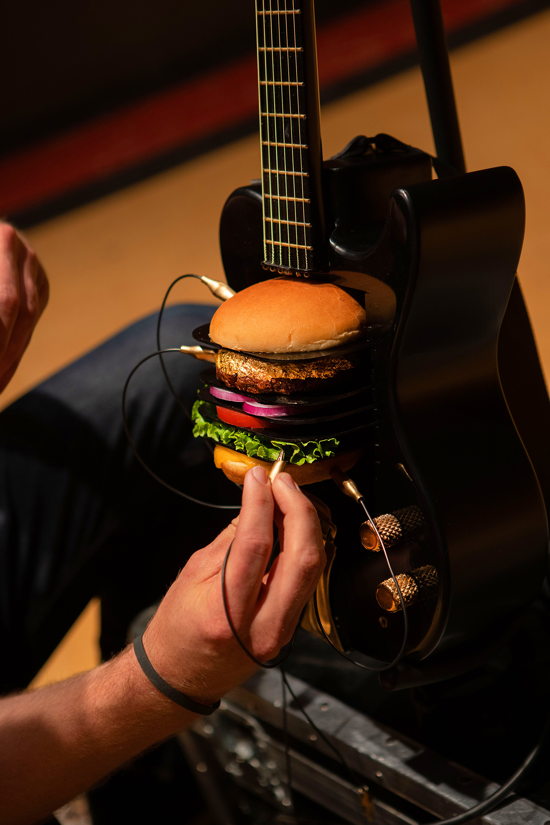 "Hard Rock Cafe releases ""The Golden Solo"", played on the world's first burger powered guitar using the new 24-Karat Gold Leaf Steak Burger(TM)."
