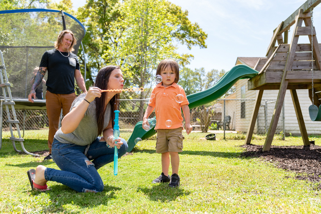 Chance, a child treated with SPINRAZA, playing with his family.