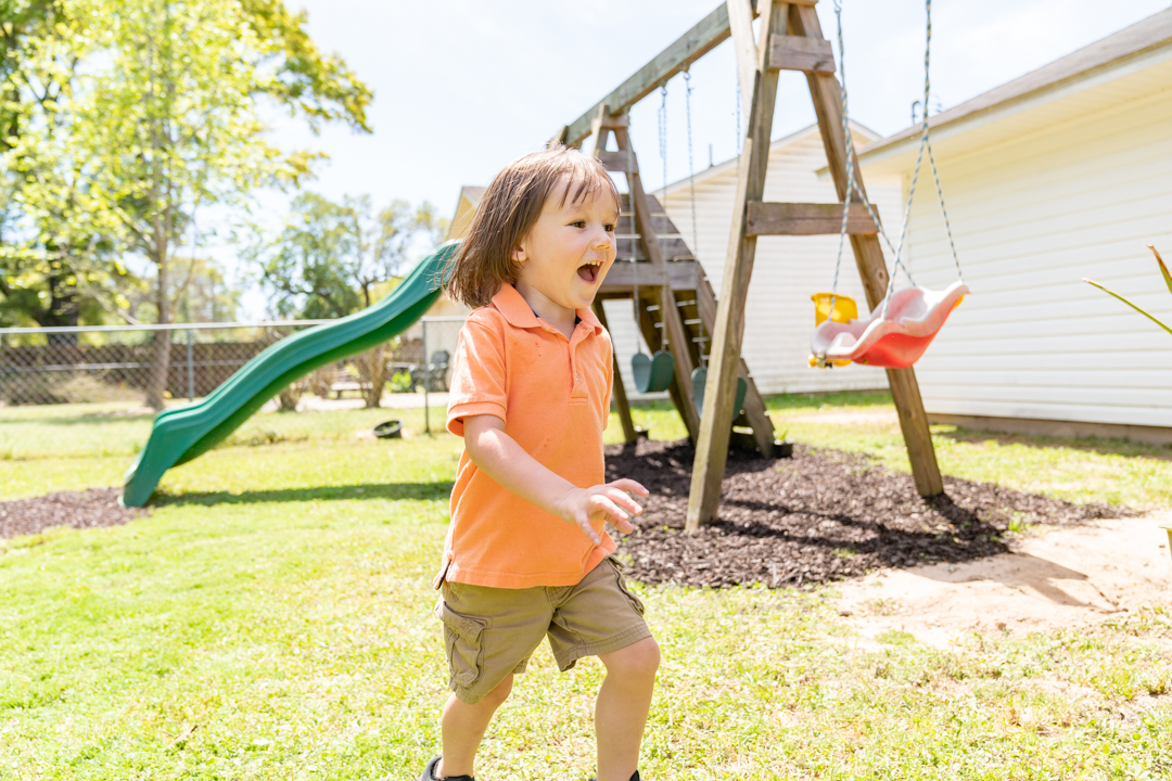 Chance, a child treated with SPINRAZA, playing in his backyard.