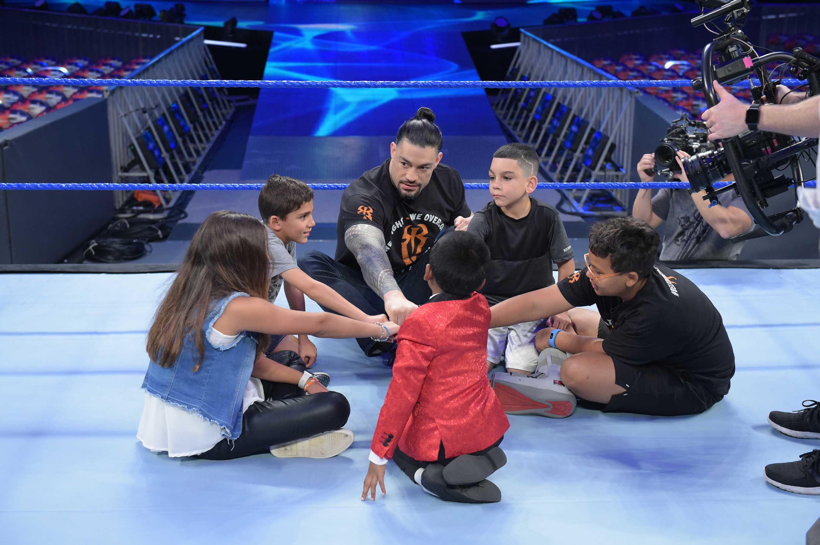 WWE superstar Roman Reigns joins young cancer survivors for an exclusive behind the scenes experience at the WWE ring