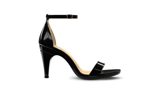 """Pashionista"" features a classic silhouette updated for the modern woman. Soft patent leather complements a simple and chic design with an adjustable ankle strap and gold buckle."