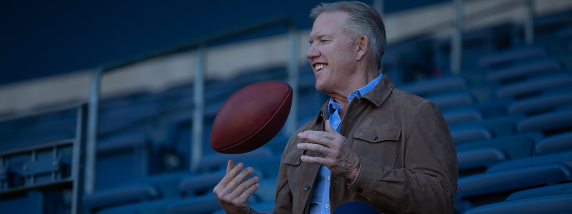Elway with a football