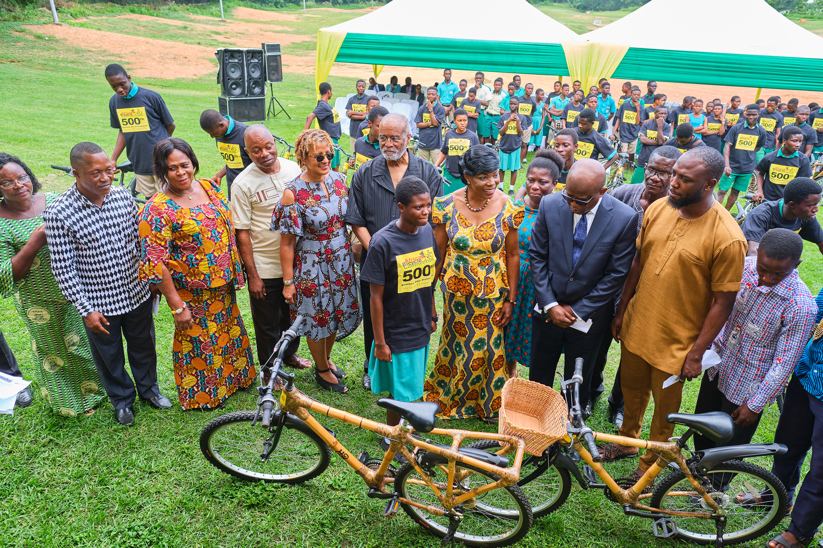 """ABCF's """"500th Bicycle"""" event speakers present bamboo bicycles to individual students, recently, in Accra. Speakers included: Mr Daniel Lawer Agudey, head teacher, Ningo Senior High School (Second from left); Ms Beatrix Ollenu, Ningo-Prampram School District Director of Education (third from left); Mr Peter Djan, Head teacher, Prampram Senior High School (fourth from left); Ms Patricia Marshall Harris, executive director, ABCF (fifth from left); Mr A.Bruce Crawley, chairman, ABCF (sixth from left); Hon. Elizabeth K. T. Sackey, Deputy Regional Minister, Greater Accra (center); and Mr. Carl Nelson, COO, Ghana Investment Promotion Centre (third from right), with bamboo bicycle recipient."""