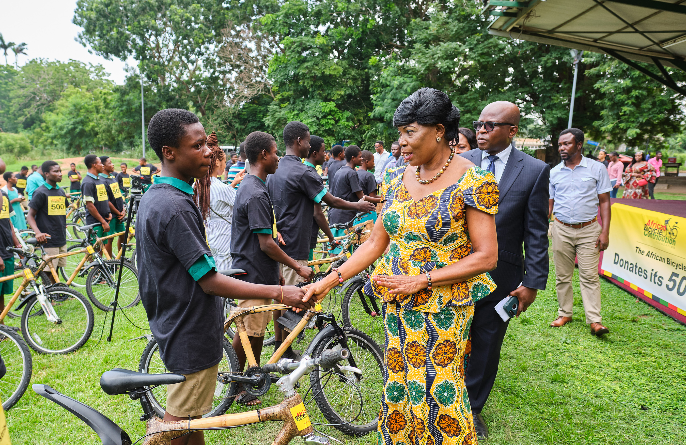 """Hon. Elizabeth K. T. Sackey (center), Deputy Regional Minister of Greater Accra and Mr. Carl Nelson (second from right), COO, Ghana Investment Promotion Centre, congratulating bamboo bicycle recipients, recently, at the African Bicycle Contribution Foundation's """"500th Bicycle"""" event, in Accra."""