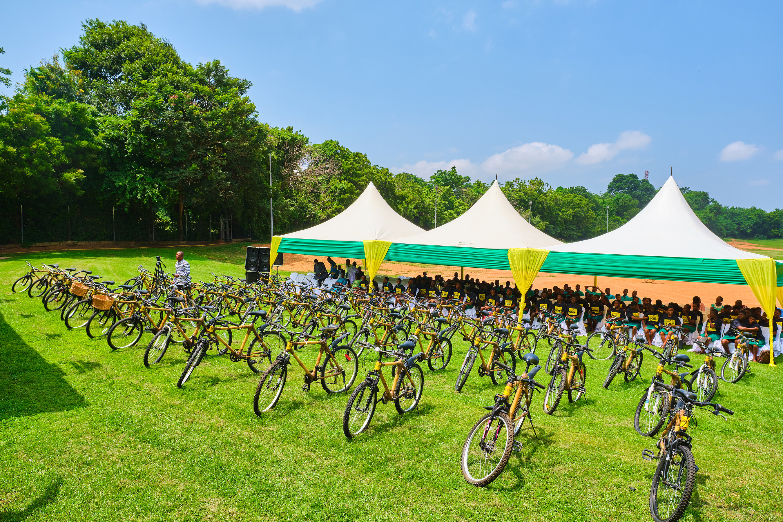 """Display of bamboo bicycles and 85 student-recipients from Ningo-Prampram School District, recently, at the start of the African Bicycle Contribution Foundation's """"500th Bicycle"""" event, in Accra."""
