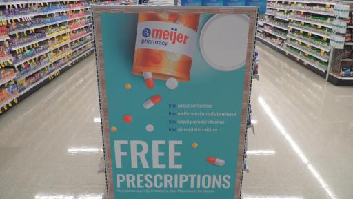 Free Prescription Drug Program banner in an aisle