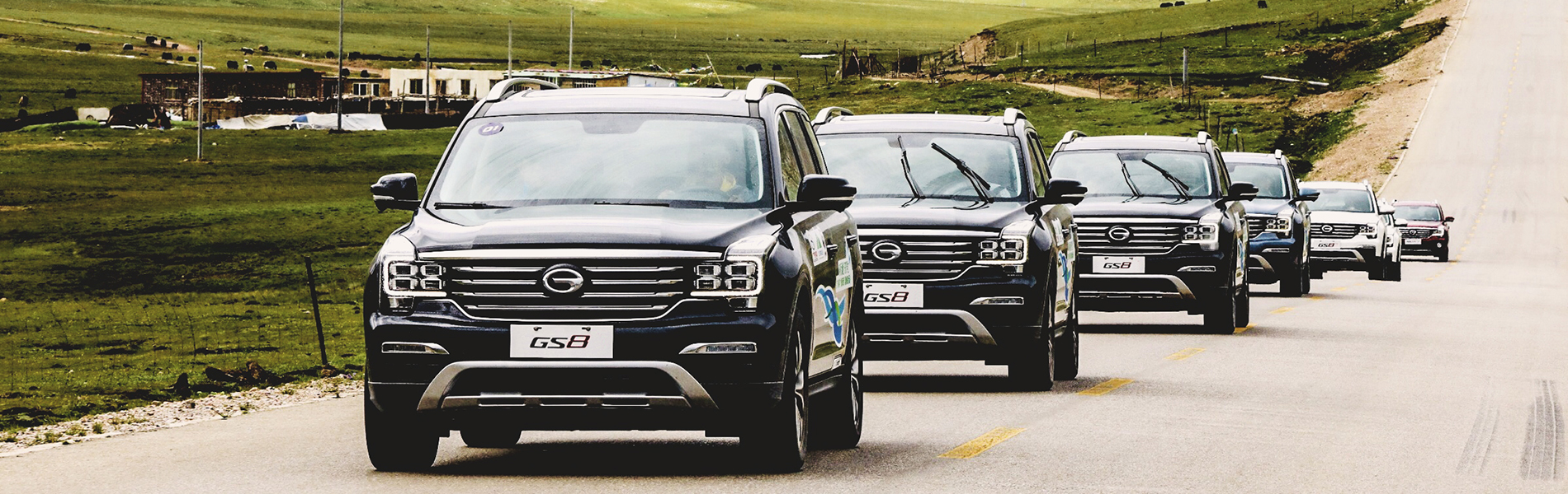 Banner image of SUVs driving down the road