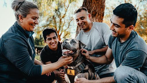 "Sergio, a Marine veteran with his sons Andy and Fernando, wife Rosa and his service dog Laramie. Sergio has been a member of ARF's Pets and Vets program since 2018. ARF has once again partnered with Purina Dog Chow for its second annual ""Service Dog Salute"" campaign to raise awareness on how military veterans suffering from PTSD and their families benefit from having a service dog."