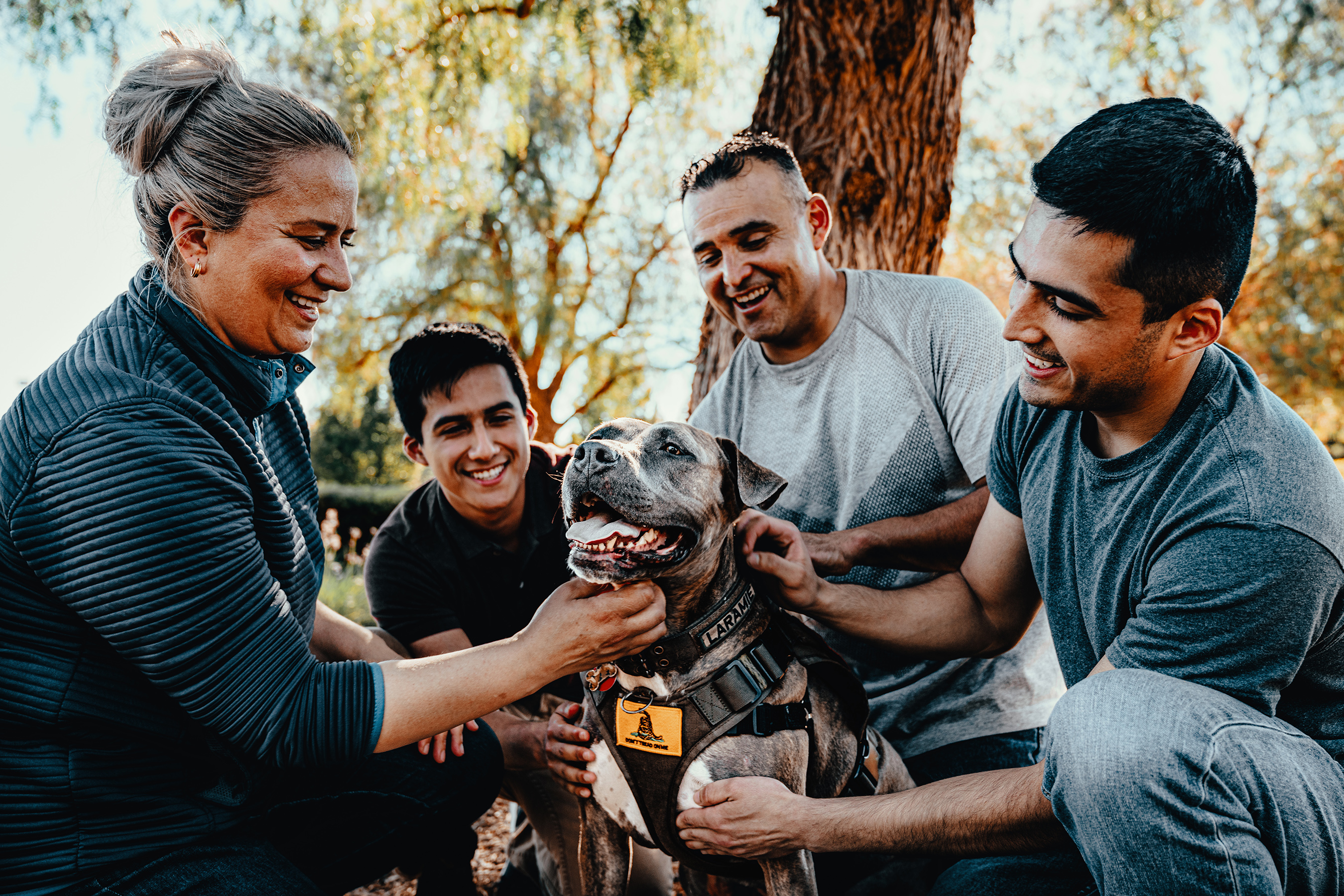 "Sergio, a Marine veteran with his sons Andy and Fernando, wife Rosa and his service dog Laramie. Sergio has been a member of Tony La Russa's Animal Rescue Foundation's Pets and Vets program since 2018. ARF has once again partnered with Purina Dog Chow for its second annual ""Service Dog Salute"" campaign to raise awareness on how military veterans suffering from PTSD and their families benefit from having a service dog."