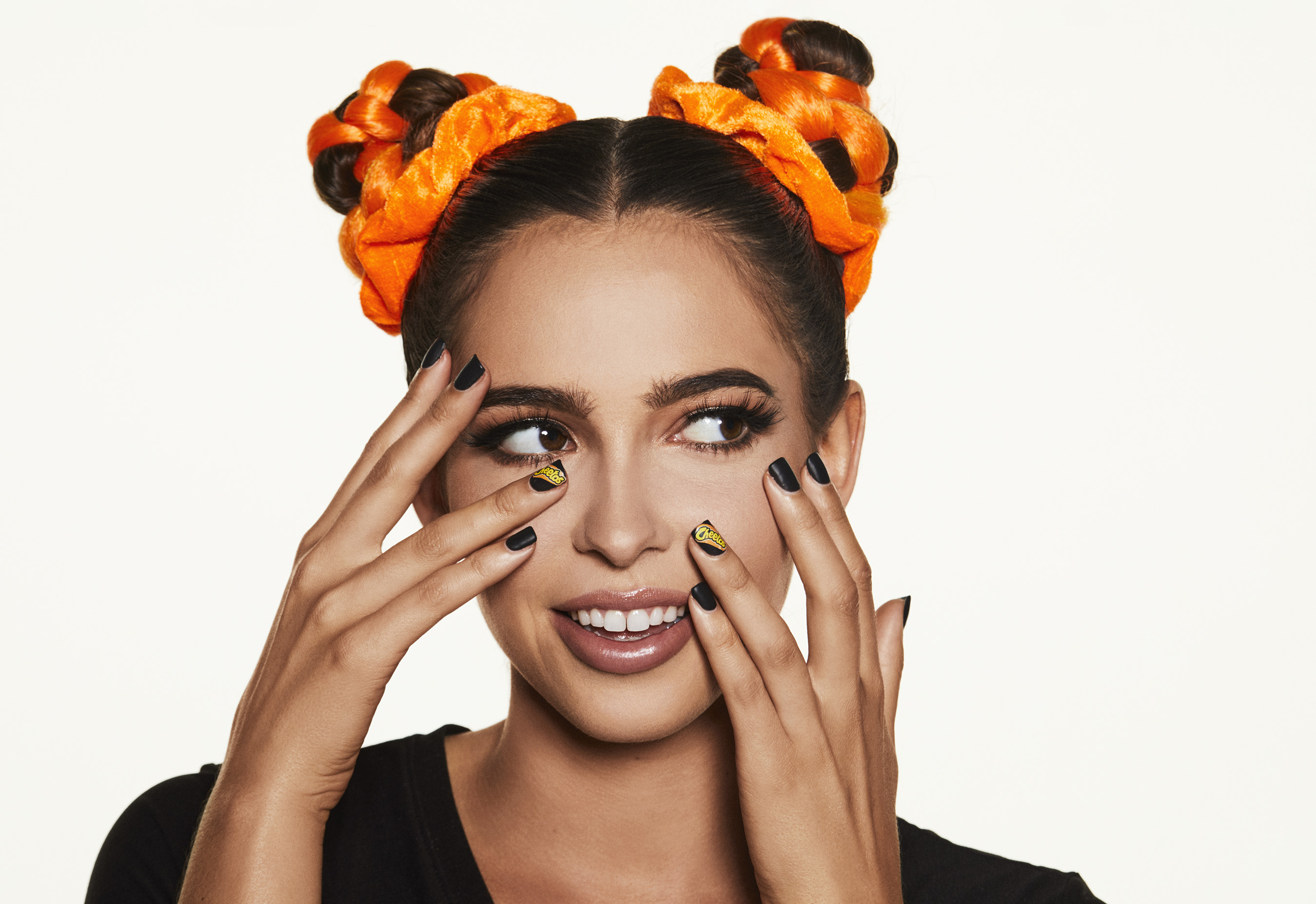 "Cheetos puts its orange-dusted fingerprints all over fashion and beauty world with ""House of Flamin' Haute"""