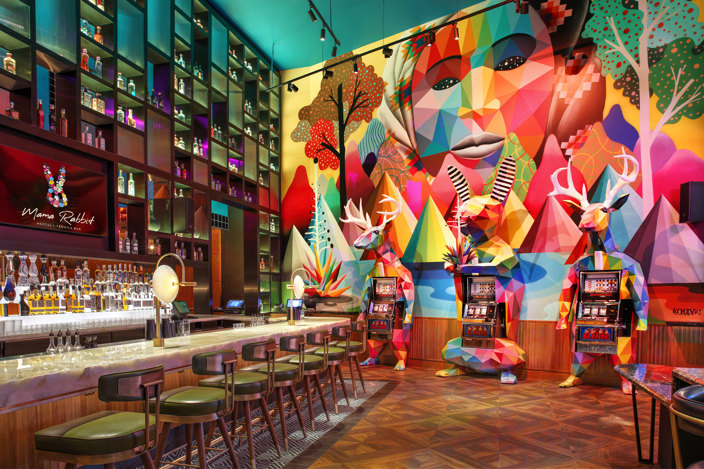 Mural and Sculptural Slot Machines by Okuda San Miguel at Mama Rabbit Bar at Park MGM in Las Vegas