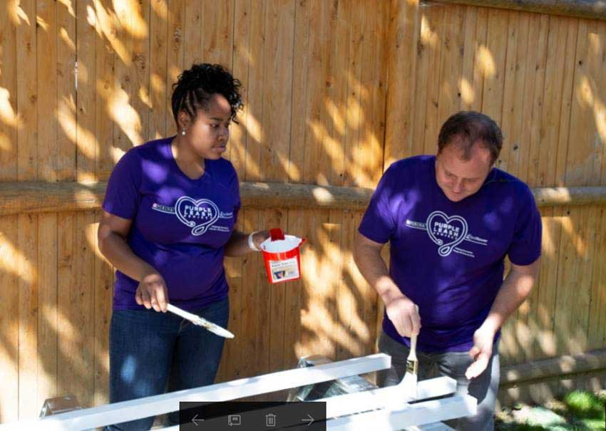 Volunteers from Purina complete a painting project at a shelter in Auburn, ME. The team helped create pet-friendly spaces including kennel areas and cat bridges to allow people and pets to bond together in safe, private areas.