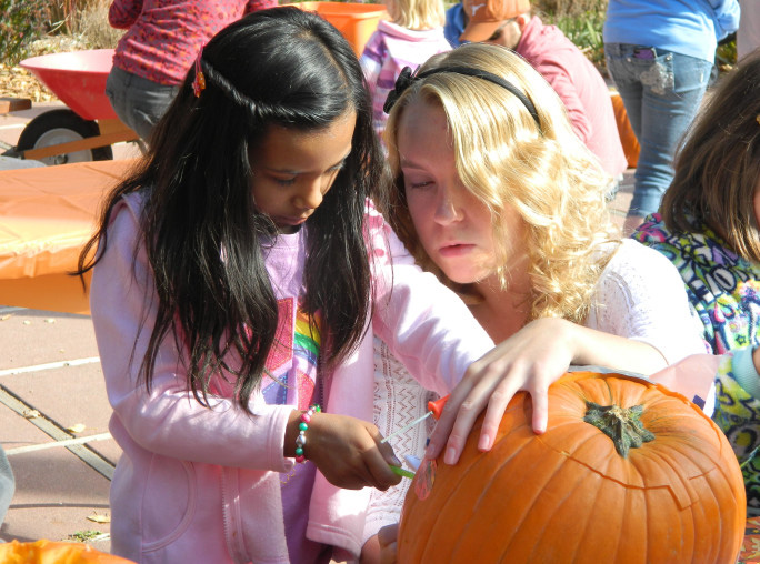 Learning how to carve a pumpkin with Pumpkin Masters tools. Photo credit: Los Alamos Arts Council.