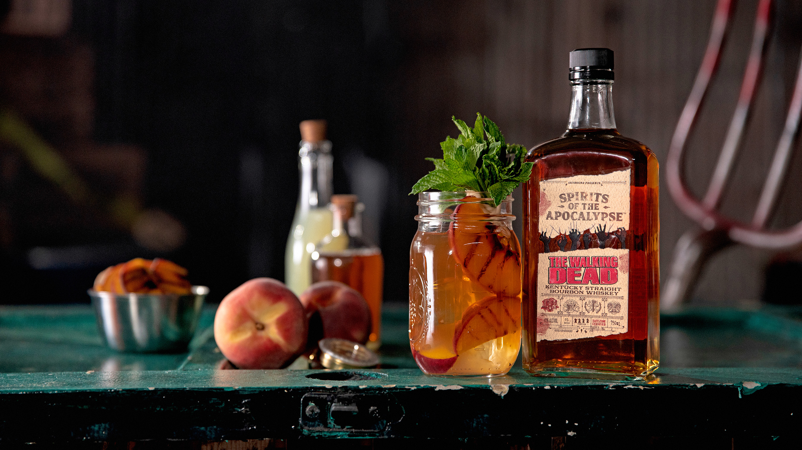 Maggie's Lemonade - 1.25 oz limited-edition The Walking Dead Kentucky Straight Bourbon Whiskey, 2 oz lemonade and 2 oz peach tea. Garnish with mint and grilled peaches.