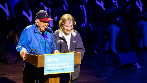 Jimmy and Rosalynn Carter giving a speech for Habitat for Humanity
