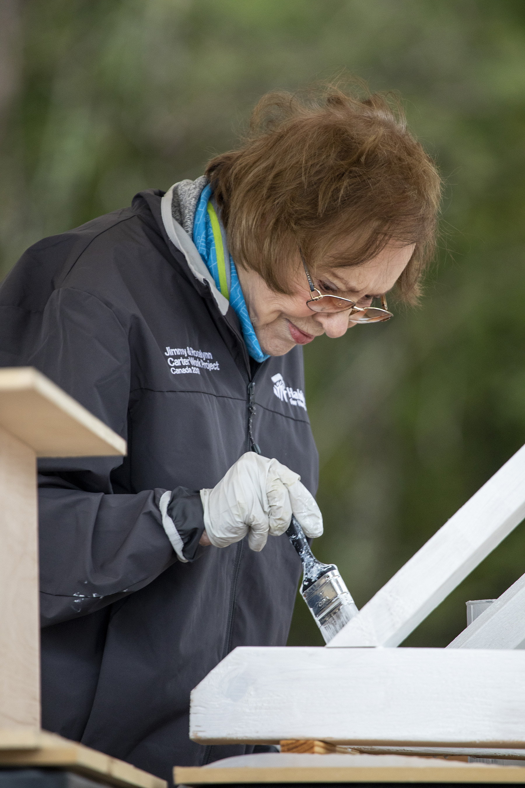 Former First Lady Rosalynn Carter paints corbels for new Habitat for Humanity homes in Nashville on Monday, Oct. 7. She and former President Jimmy Carter have volunteered with Habitat since 1984.