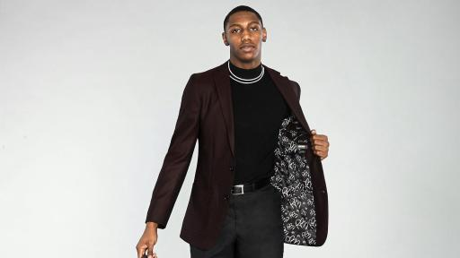RJ Barrett in Tweed Burgundy Blazer with Signature Lining holding a leather bag