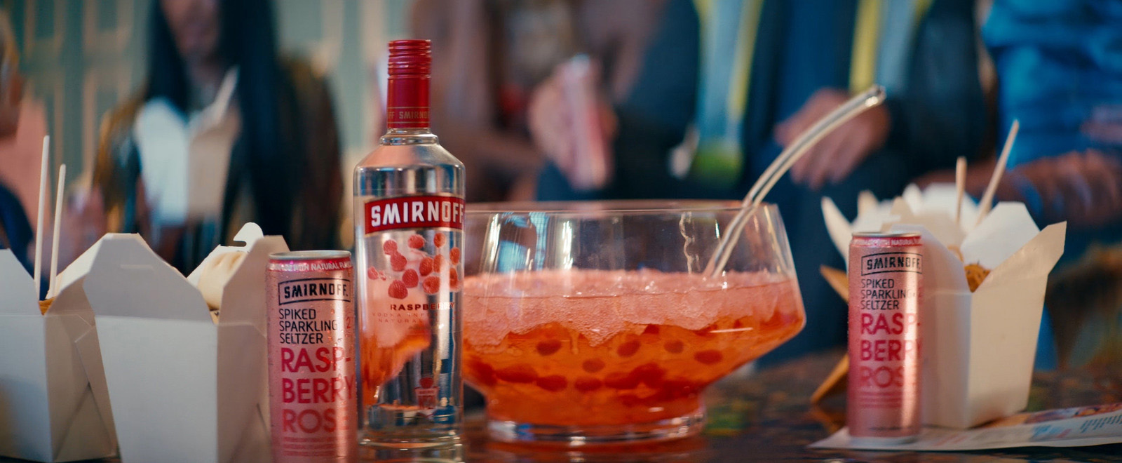 Smirnoff Raspberry and Smirnoff Raspberry Rosé Seltzer steal the show as the perfect pairings for Chinese takeout at Smirnoff's holiday party.