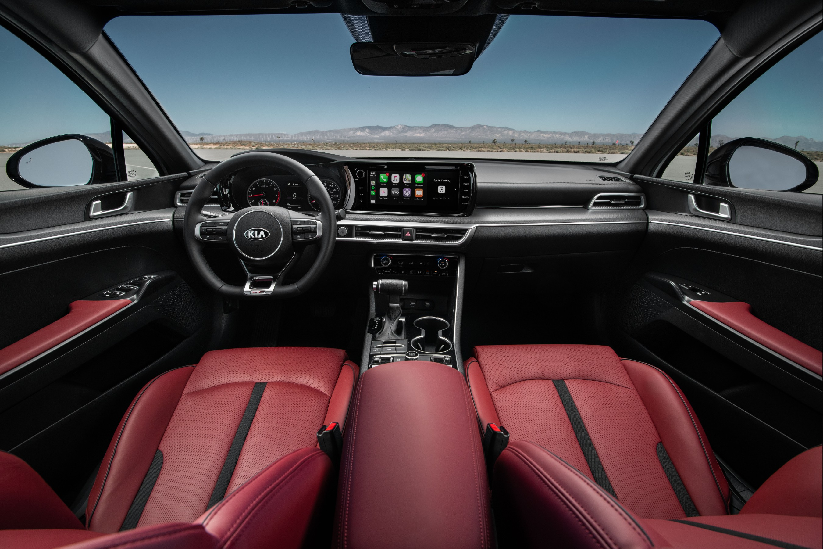 A driver-centric cabin offers deeply bolstered seats, advanced technology and is available in sporty red leatherette.