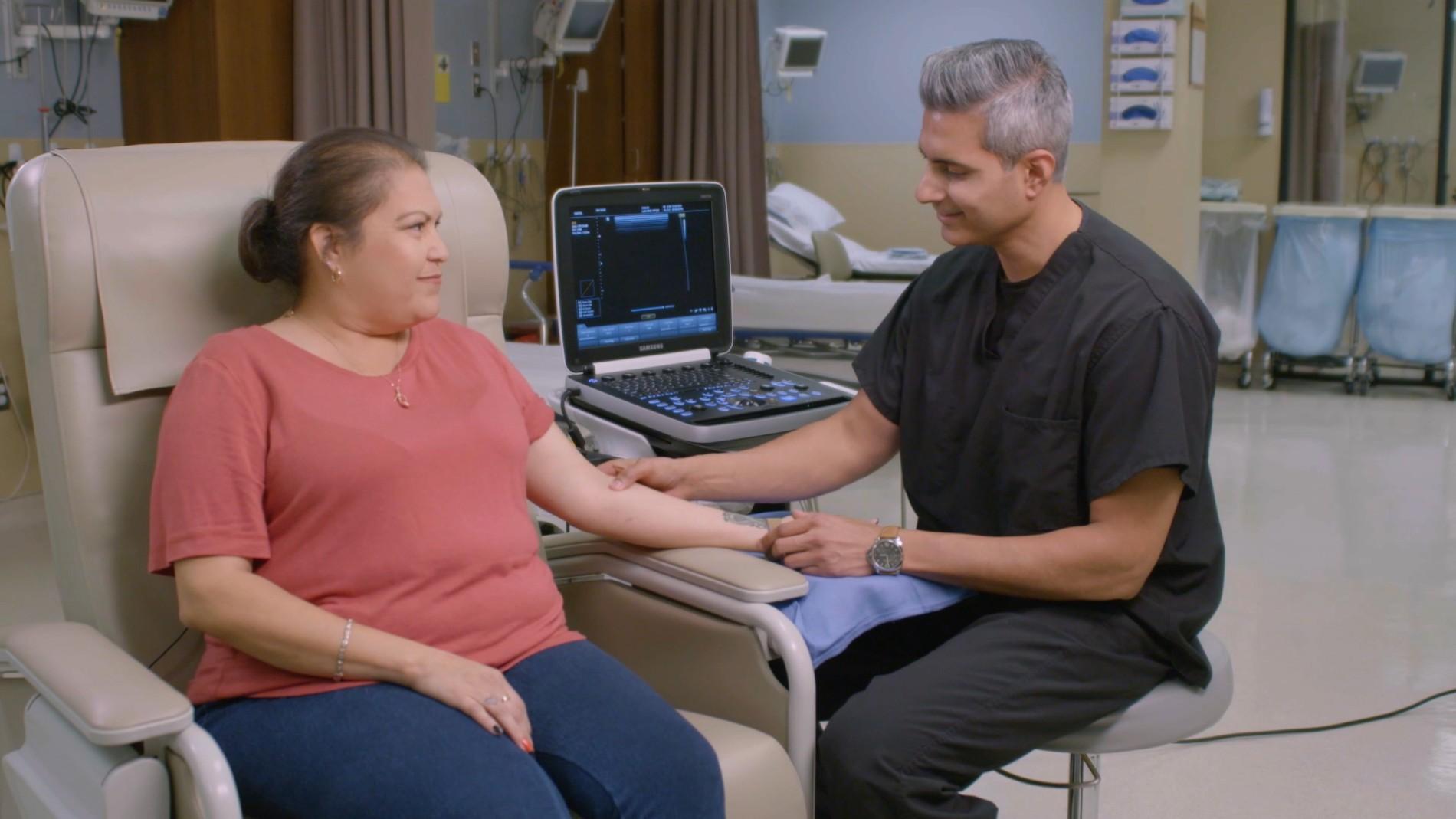Nephrologist Umar Waheed checks the status of Ellipsys patient Theresa Torres' fistula using ultrasound.
