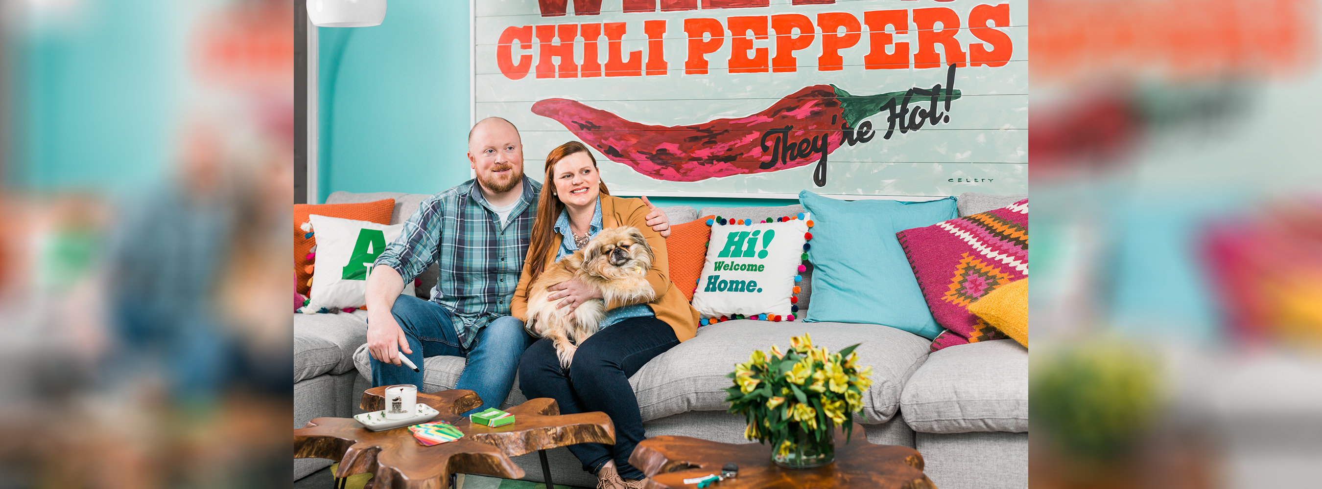 Couple sitting in their Chili's decorated living room.