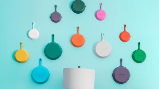 Several skillets hanging on a wall
