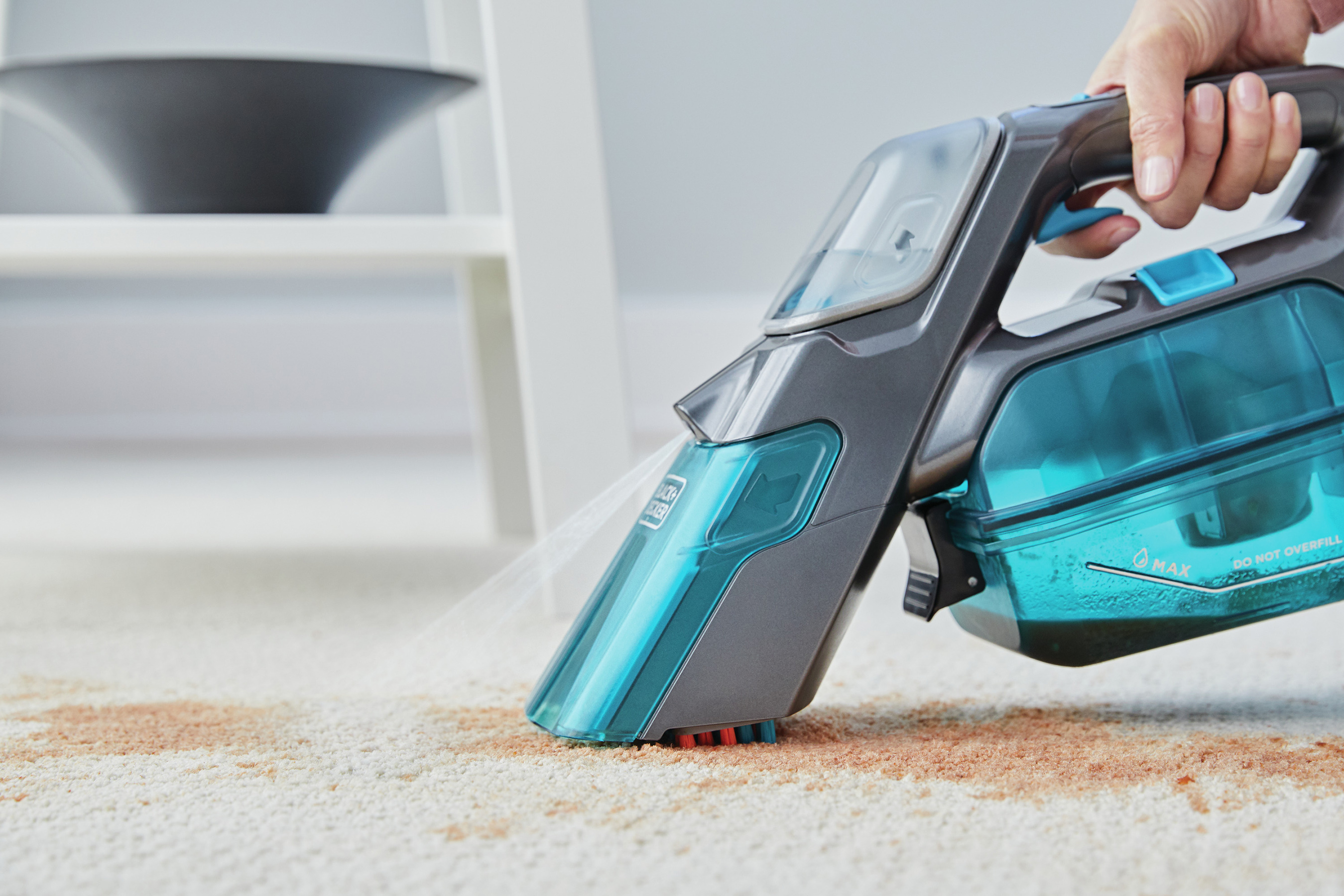 Introducing the spillbustertm Cordless Spill + Spot Cleaner