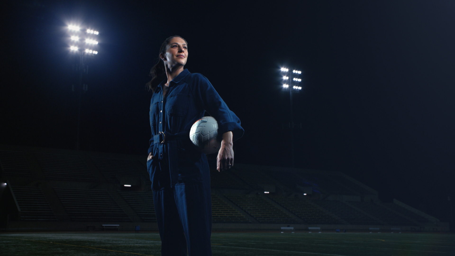 Two-time Olympic gold medalist and two-time FIFA Women's World Cup champion, Carli Lloyd, strikes a powerful stance on the soccer field in her Rosie Reborn jumpsuit. Photo Credit: Cotton Incorporated