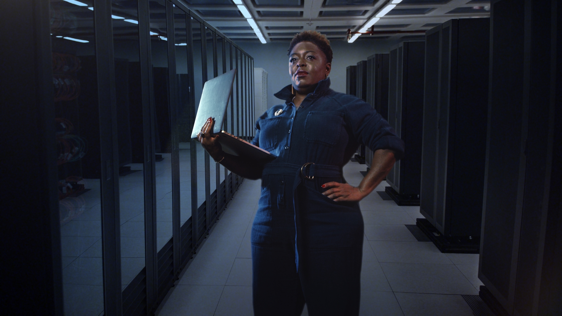 Nationally recognized electrical engineer and founder and CEO of Black Girls Code, Kimberly Bryant, is shown helping the next generation while wearing her Rosie Reborn jumpsuit. Photo Credit: Cotton Incorporated