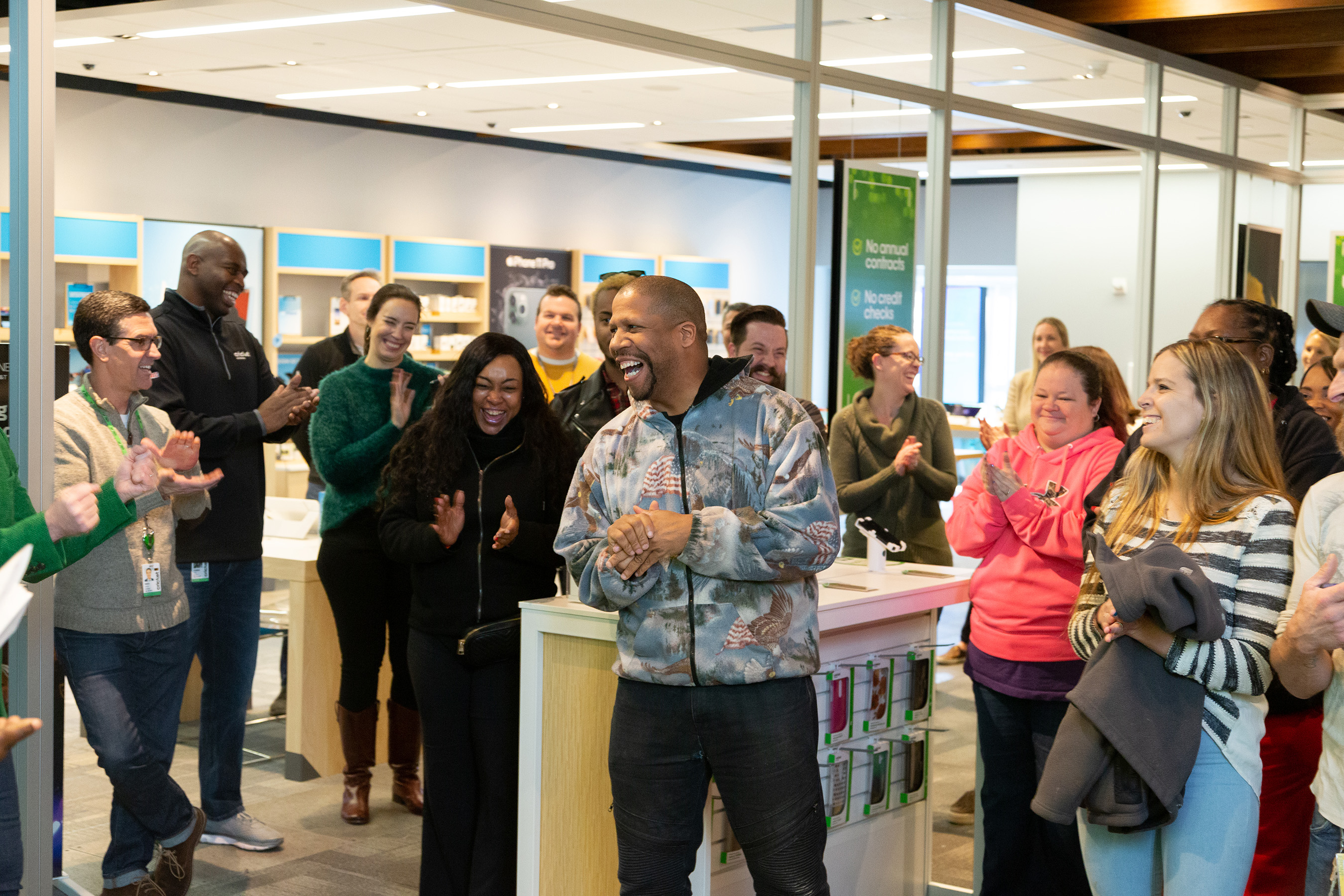 In Atlanta - Cricket's hometown market - 12 deserving families were surprised with extra holiday cheer. Winner Jerry Lacy's smile is contagious as he celebrates with other families and Cricket employees.