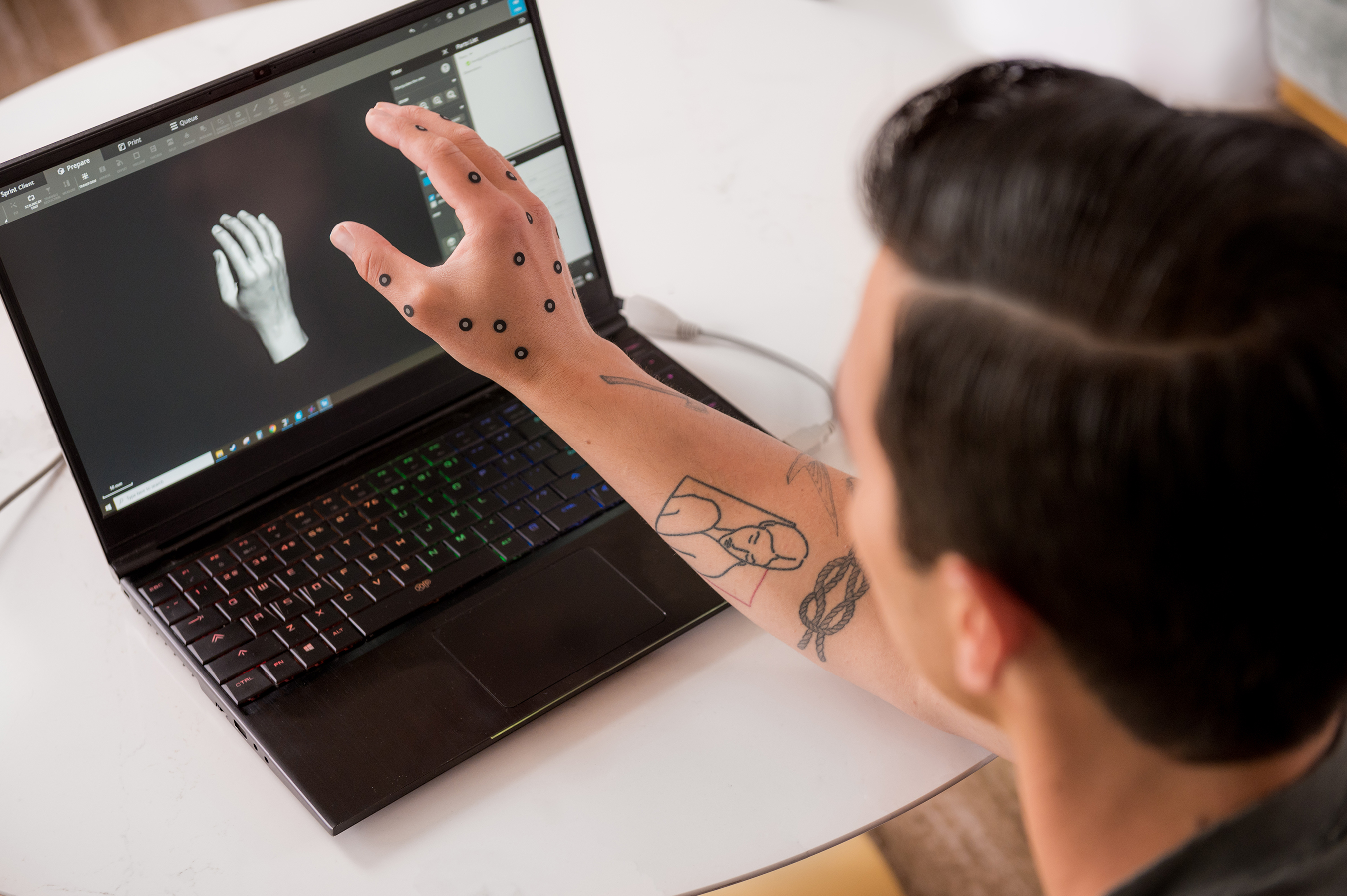A perfect match - Joe Jonas checks out the accuracy of the replica scan of his hand, which will soon become the Expedia Helping Hand