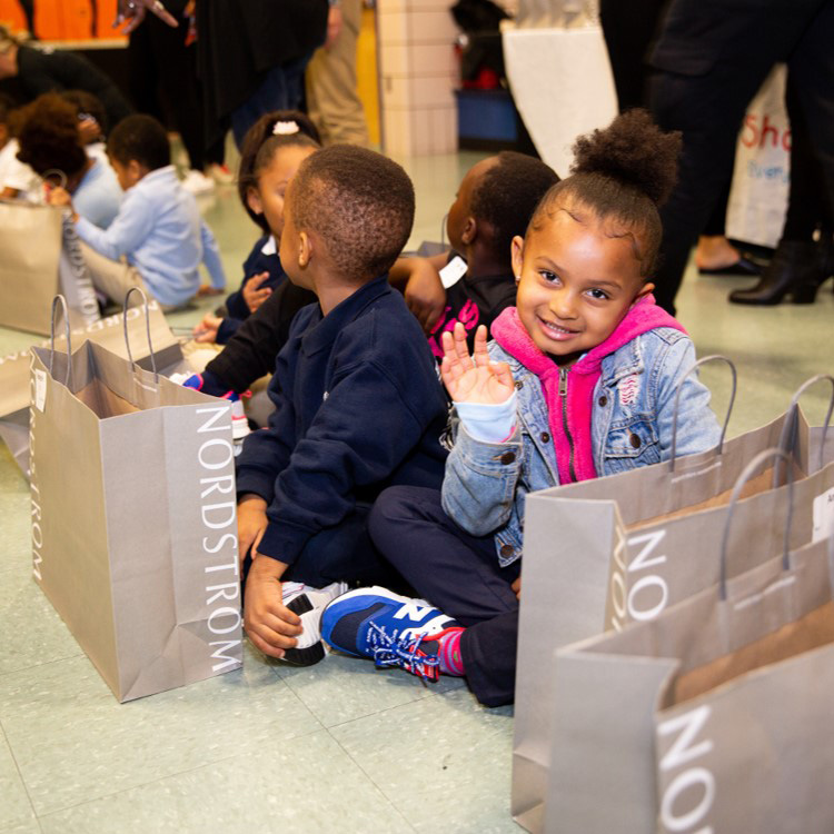 Nordstrom and Shoes That Fit visited elementary schools in 2019 to deliver new sneakers to kids.