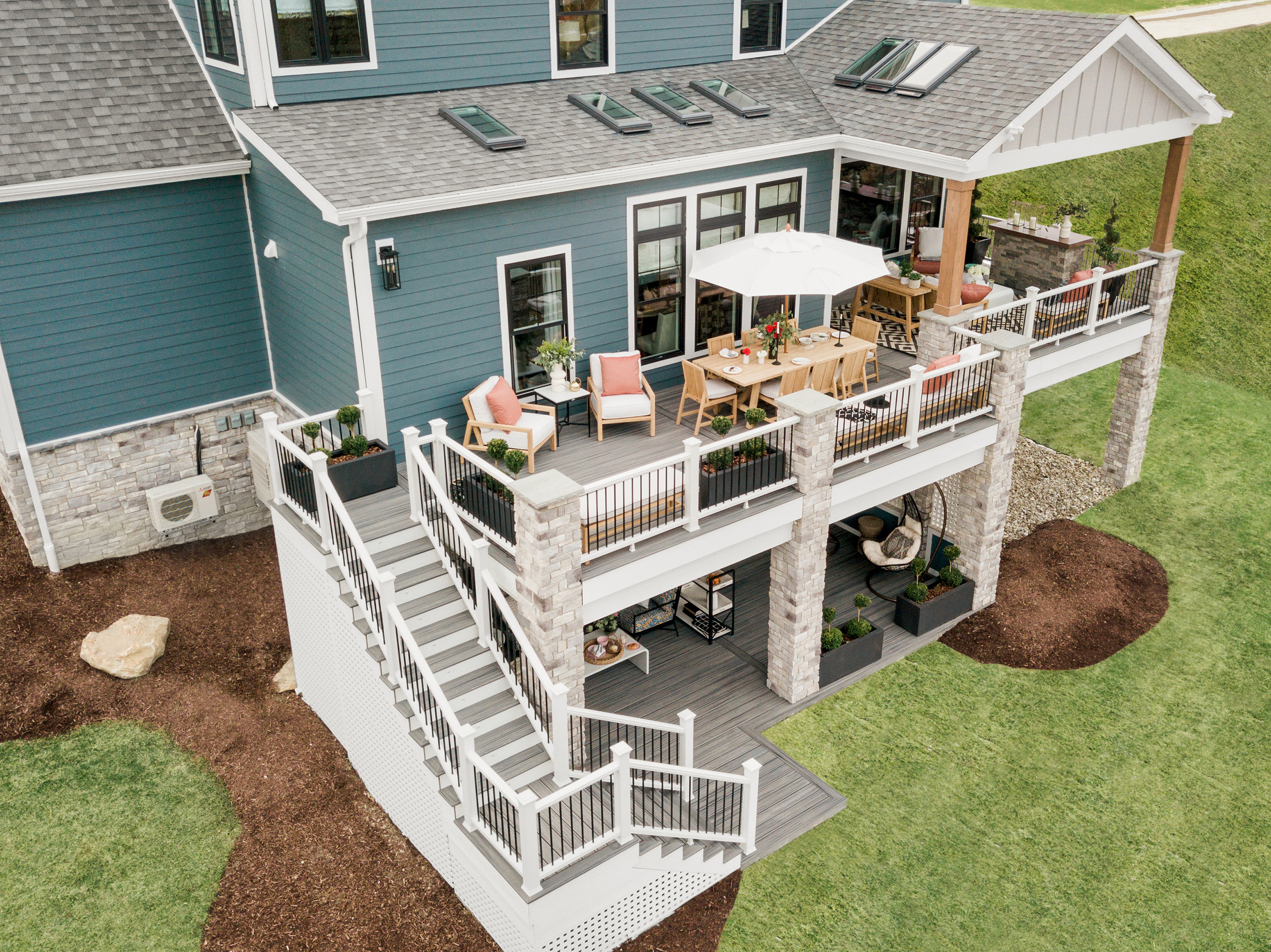 The HGTV Smart Home 2020 backyard is a cozy retreat complete with an upstairs and downstairs patio, as well as a personal pergola.