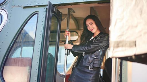 Jessica Jung hanging onto the handrail of a bus