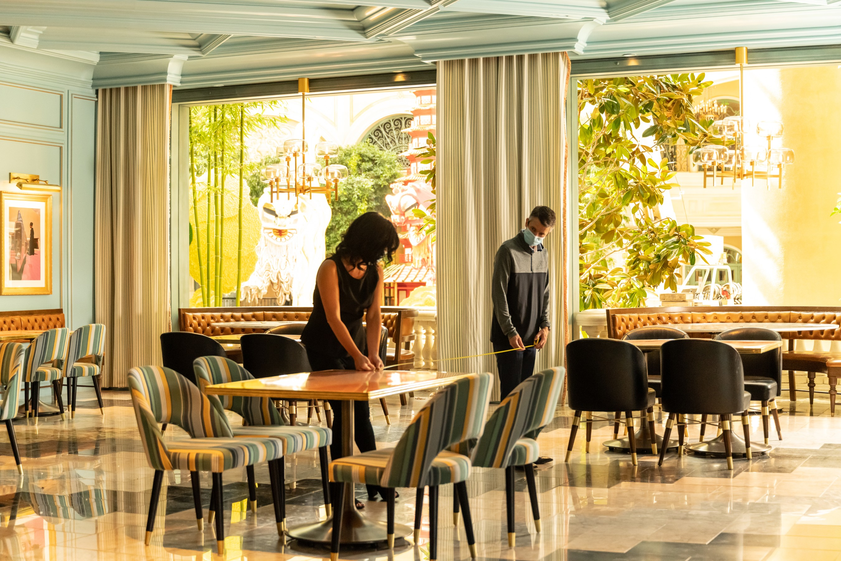 MGM Resorts' employees reconfigure dining spaces at Sadelle's Café in Bellagio to allow for physical distancing between guests.